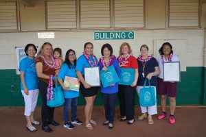 The 'Ohana Readers team with Rep. Lynn DeCoite, Mrs. Ige and coordinator Kui Adolpho.