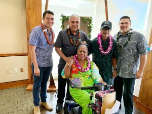 DHHL director William Aila, Jr. with beneficiary Nani Kinimaka Davis and her 'ohana, joined by Tyler Gomes and Rep. Ty Cullen. She accepted a lot in DHHL's Ka'uluokaha'i project in Kapolei.