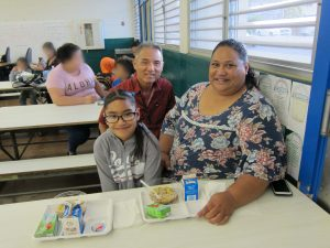 Fern Elementary principal Glen Miyasato, parent Hala Leitu and daughter Abriella,-- fans of Jump Start Breakfast.