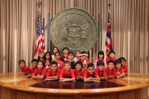 Faces of the future: Lunalilo School students visit the ceremonial room at the State Capitol.