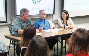 Governor Ige with state Department of Health director Bruce Anderson and epidemiologist Sarah Park at a recent news conference on COVID-19.