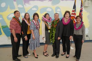 Ewa Makai Middle School teacher Miki Cacace with Governor and Mrs. Ige, and (from left) district superintendent Sean Tajima, principal Kim Sandes, Hawai'i Board of Education chair Catherine Payne and state superintendent Christina Kishimoto.