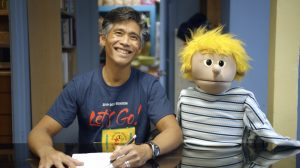 "HTY company actor Junior Tesoro and a puppet friend welcome viewers to the new online series ""The HI Way."""