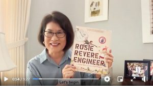 """Mrs. Ige with """"Rosie Revere, Engineer,"""" the first book in the Storytime series."""