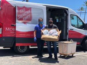 Team member Jason Kasamoto helps the Salvation Army with food distribution.