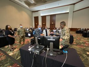 Governor Ige, Chief of Staff Linda Takayama with National Guard contact tracers. At far left, DOH branch chief Dr. Emily Roberson and HI-EMA director Kenneth Hara.