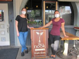 The Nook owners Hailey Berkey (left) and Anicea Campanale find ways to keep their restaurant business alive.