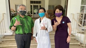 Dr. Libby Char with Governor and Mrs. Ige after their vaccinations.