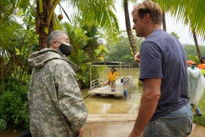 Kaua'i resident Laird Hamilton confers with Governor Ige as volunteers ferried supplies to the Hanalei community hard-hit by the flooding.
