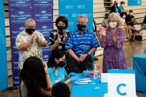 New interim Department of Education superintendent Keith Hayashi, Hawai'i First Lady Dawn Amano-Ige, Governor Ige and First Lady Dr. Jill Biden congratulate those getting vaccinated at a pop-up clinic at Waipahu High School