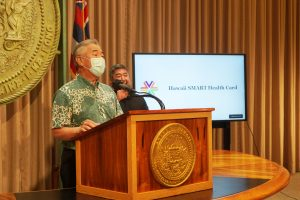Governor Ige at podium announcing Hawaii SMART Health Card